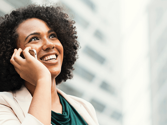 african america woman smiling while talking on the phone