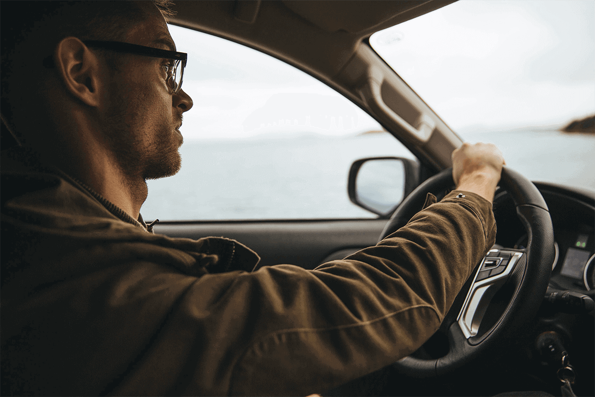 man driving with glasses on