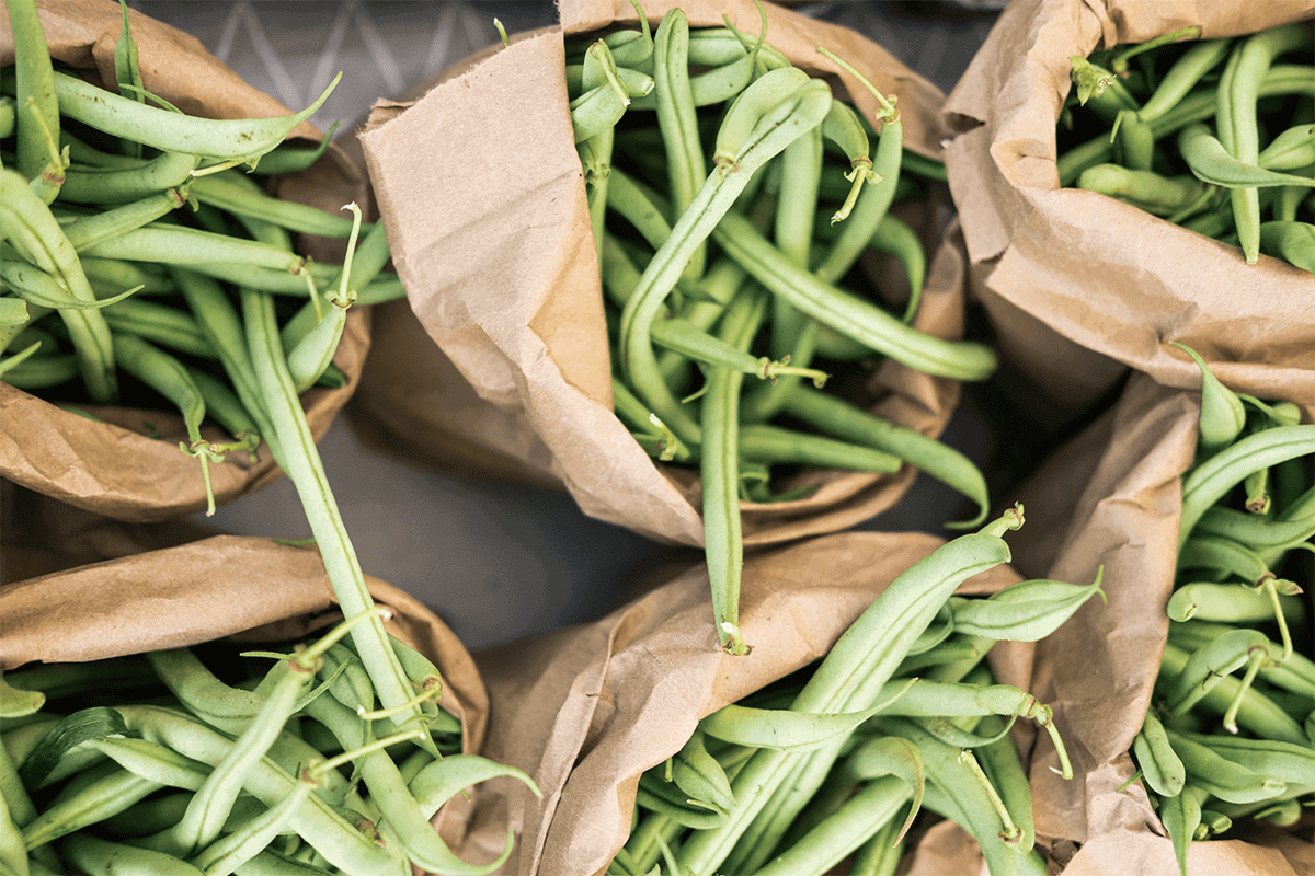 green beans in brown paper bags