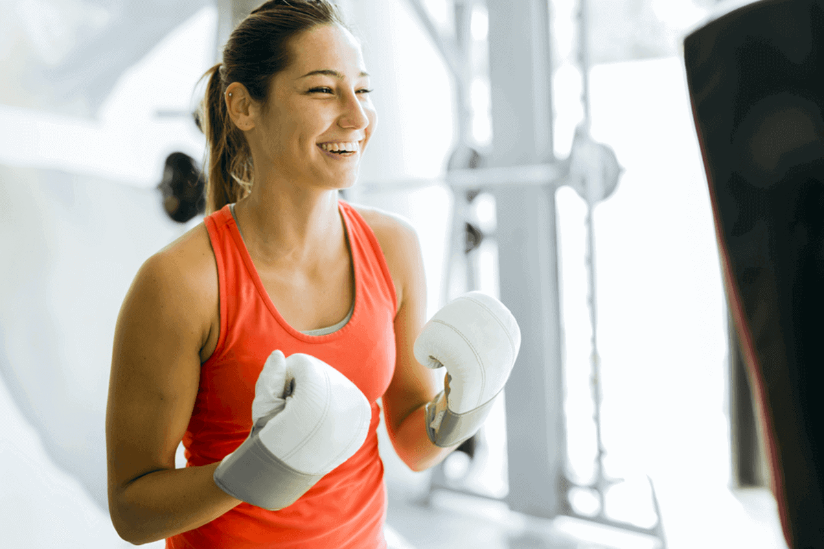 woman with two white boxing gloves on