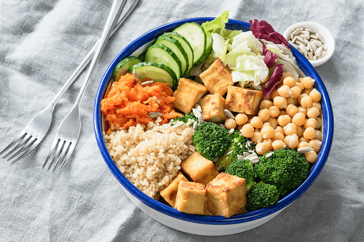 bowl of assorted foods including grains, vegetables, tofu and chickpeas