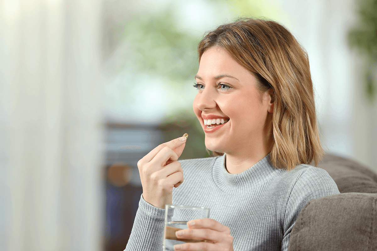 woman taking a supplement