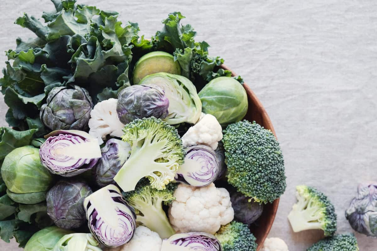 Assortment of sulfur-risch foods including broccoli, Brussels spouts, and cabbage.