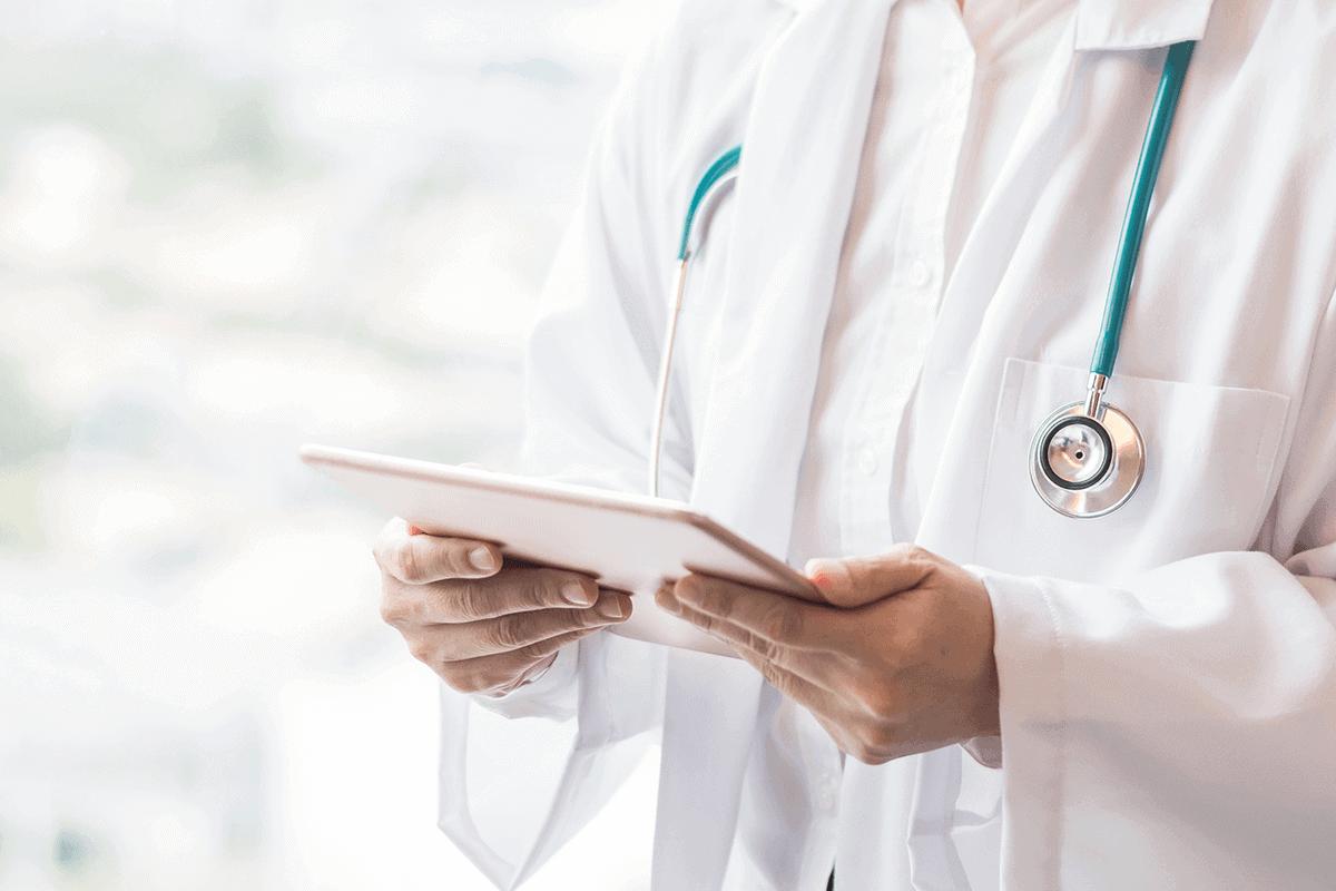 health practitioner holding tablet