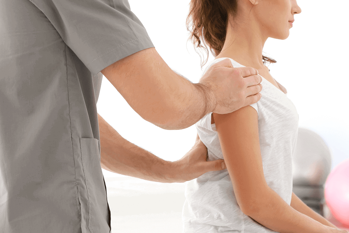 doctor working on woman's back pain