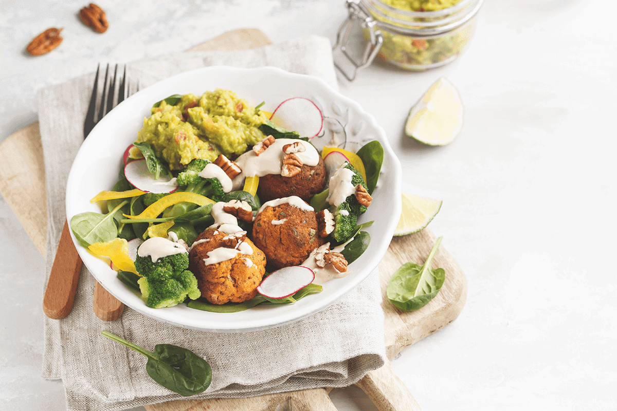 vegan salad with greens and falafel