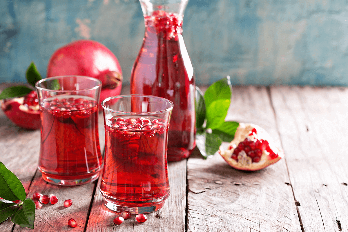 Glasses of water infused with pomegranate