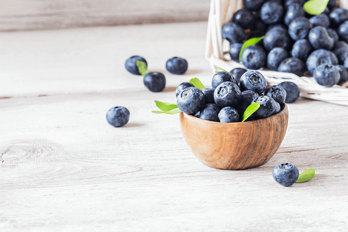 Fresh blueberries in a small wooden bowl