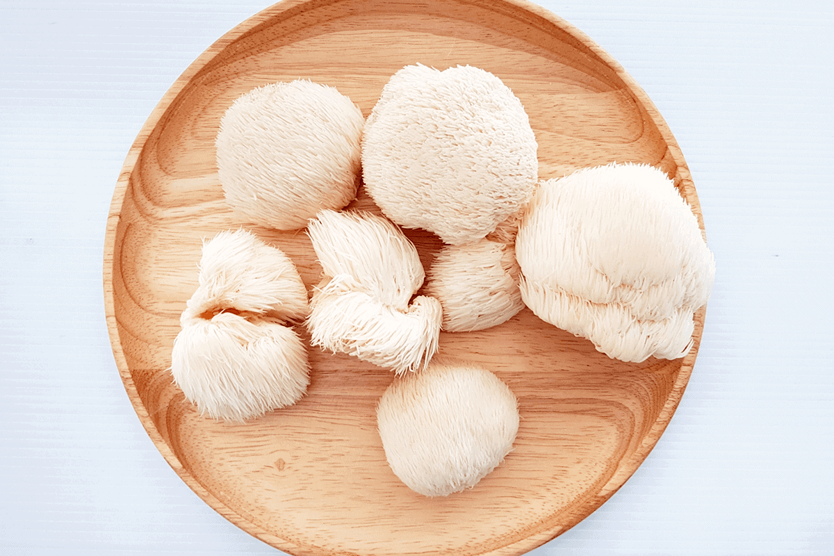 Lion's mane mushrooms on a wooden plate.