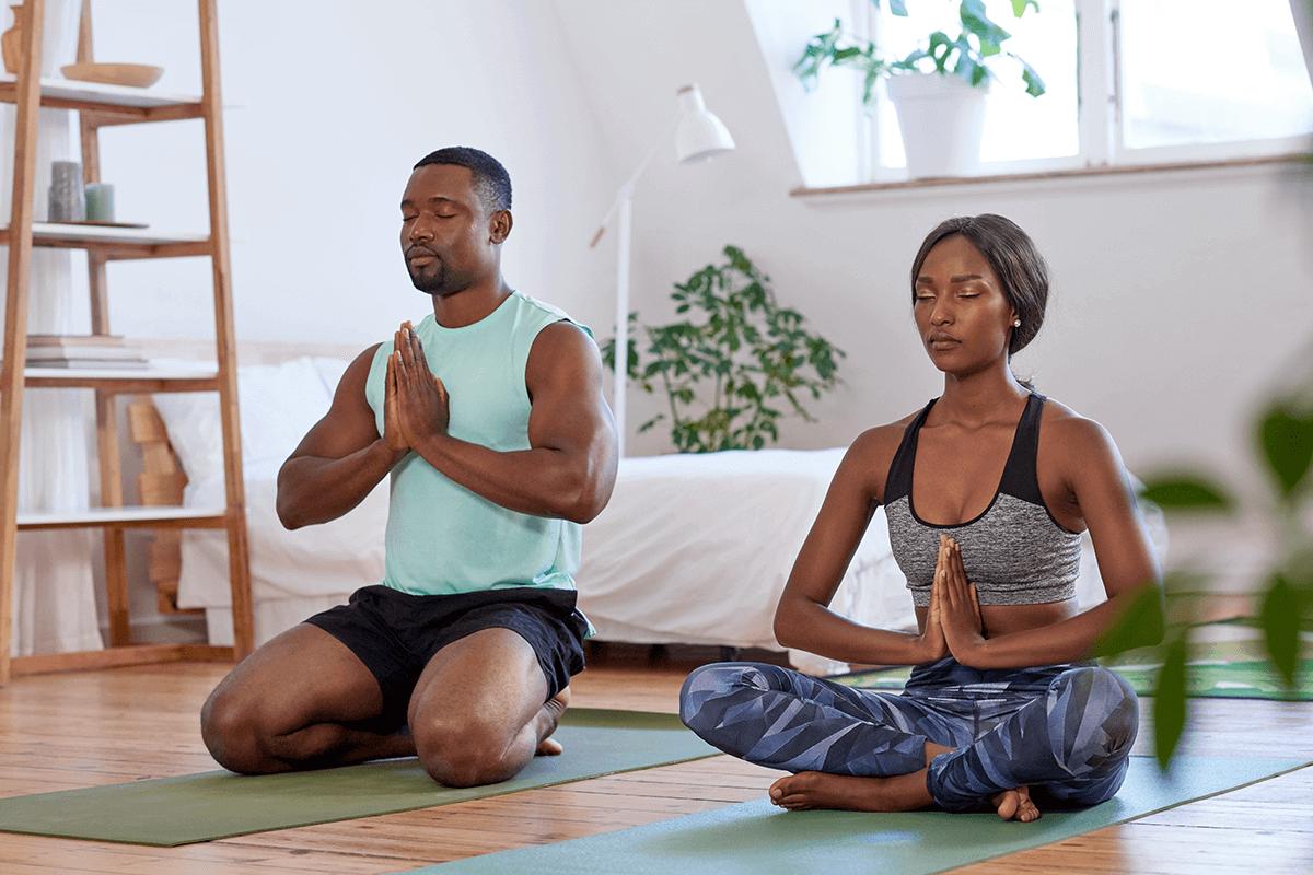 man and woman meditating