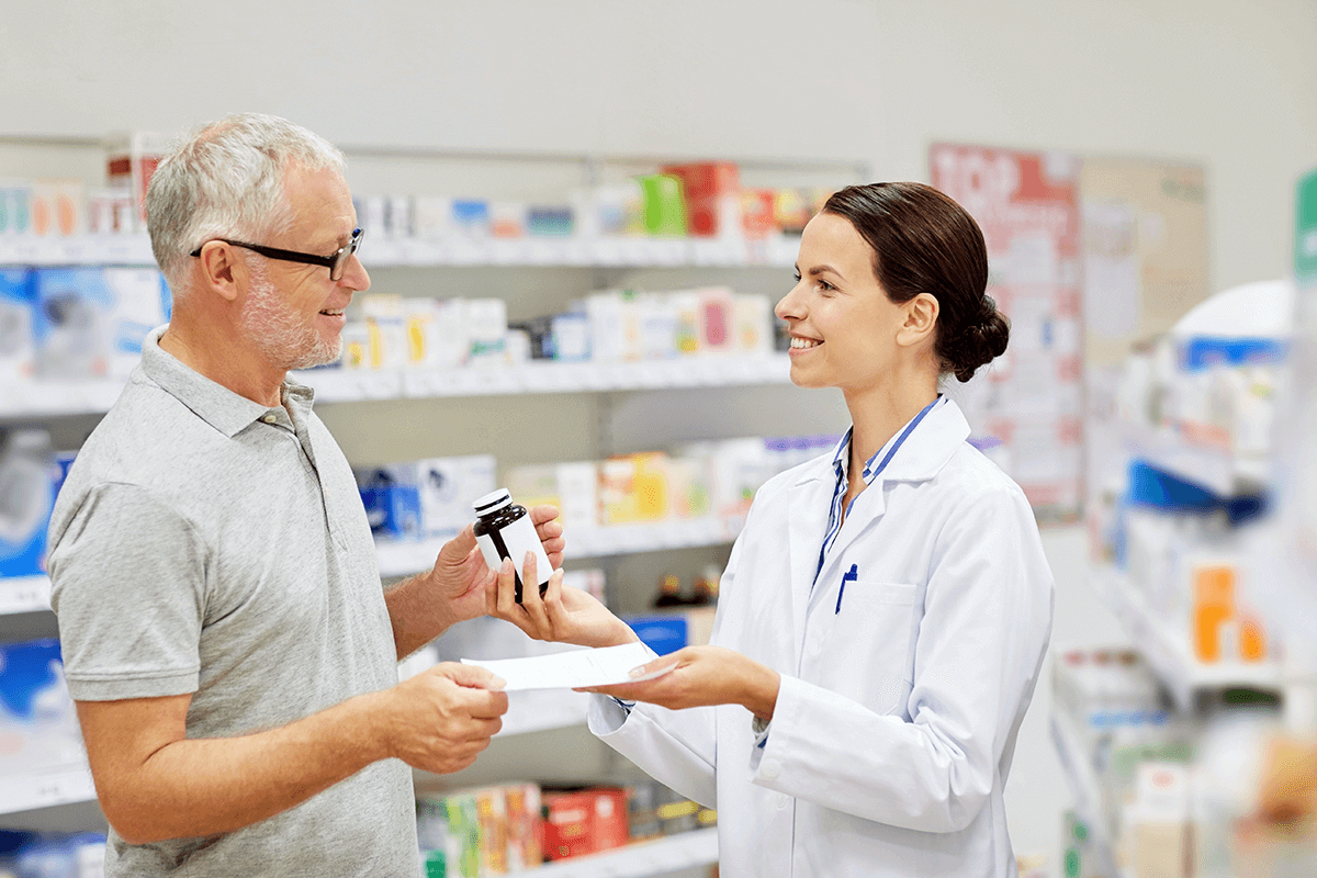 person talking to pharmacist in store