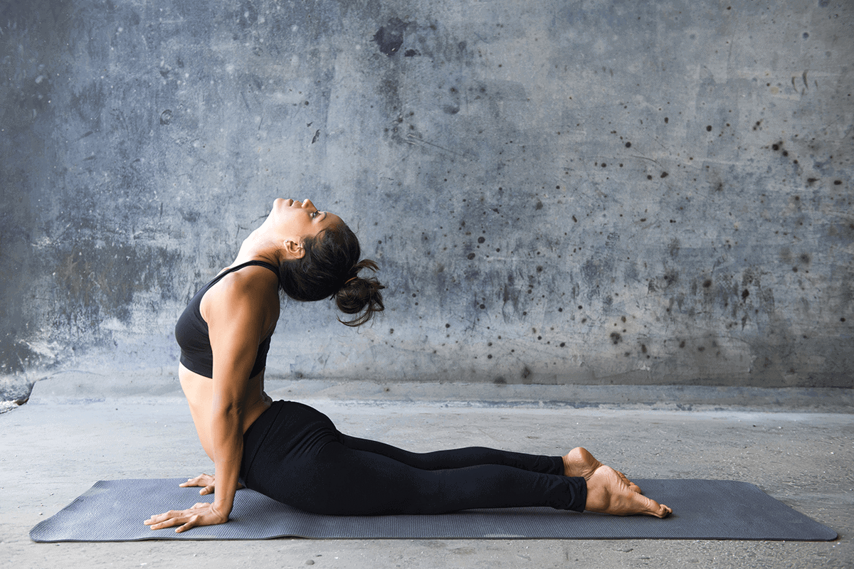 woman stretching her back in a yoga position