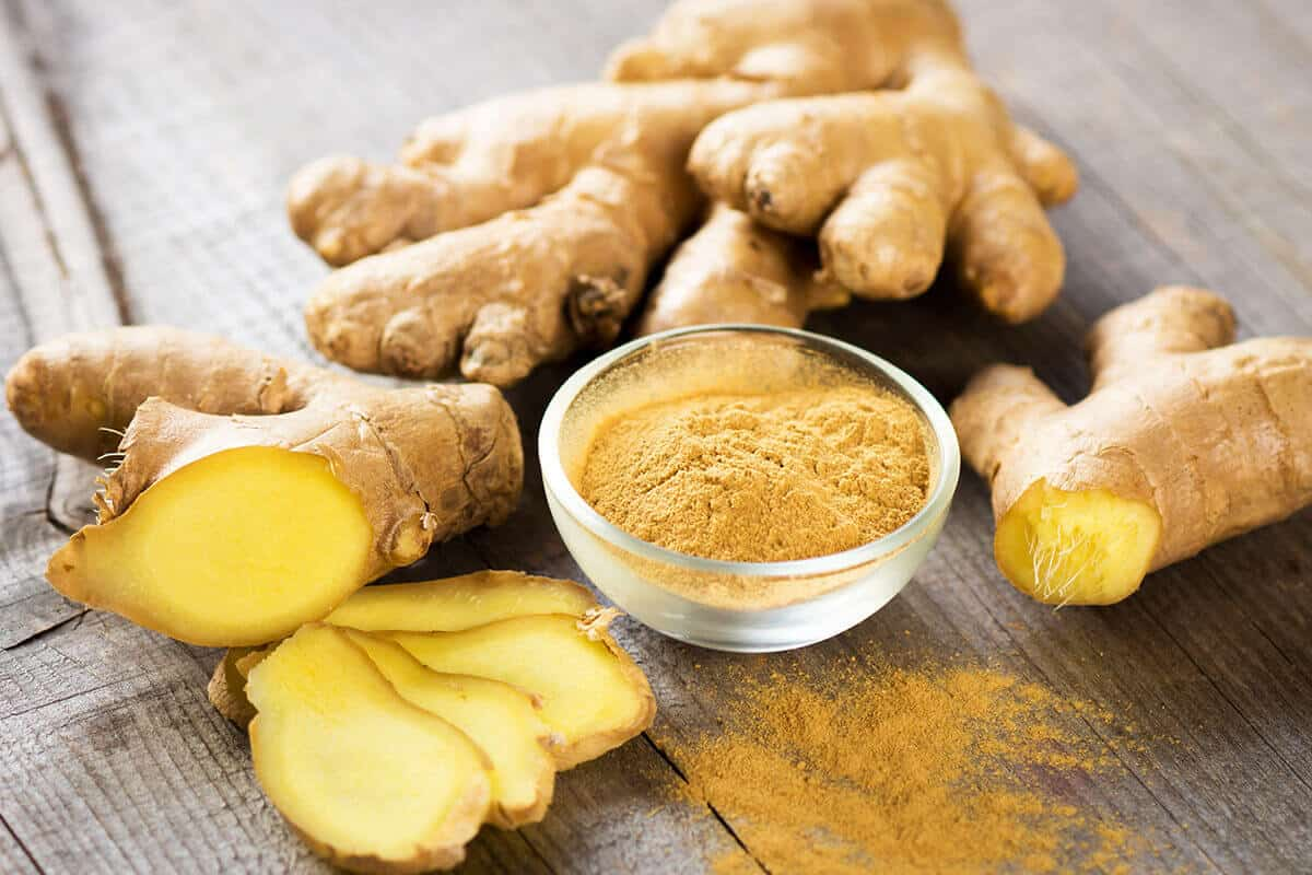 ginger plant and powder in a clear bowl