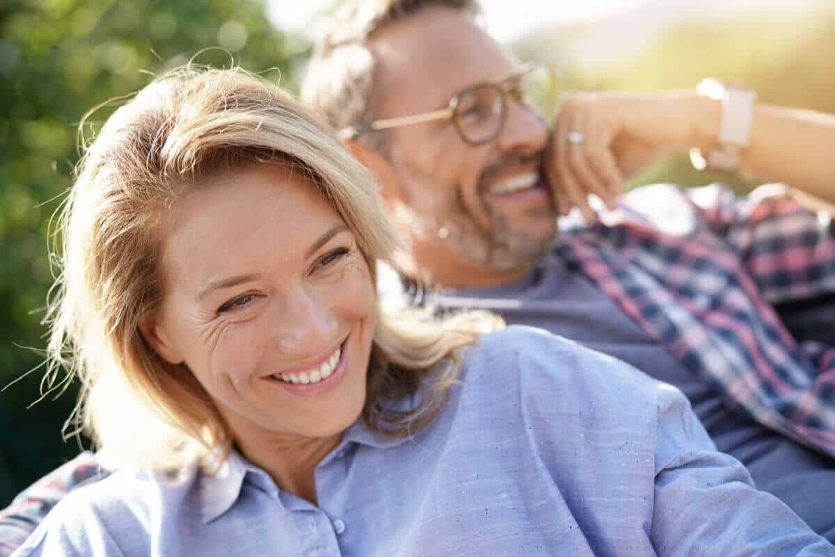 man and woman sitting together and smiling