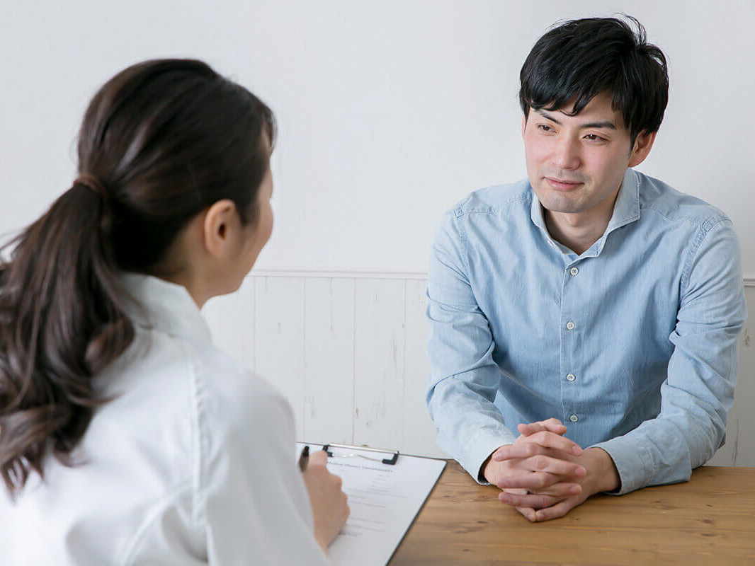 practitioner talking to a patient