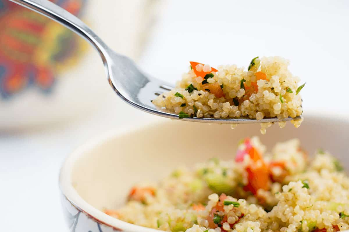 quinoa in a bowl fork lifting with quinoa