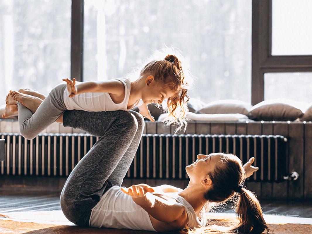 mom and daughter yoga pose