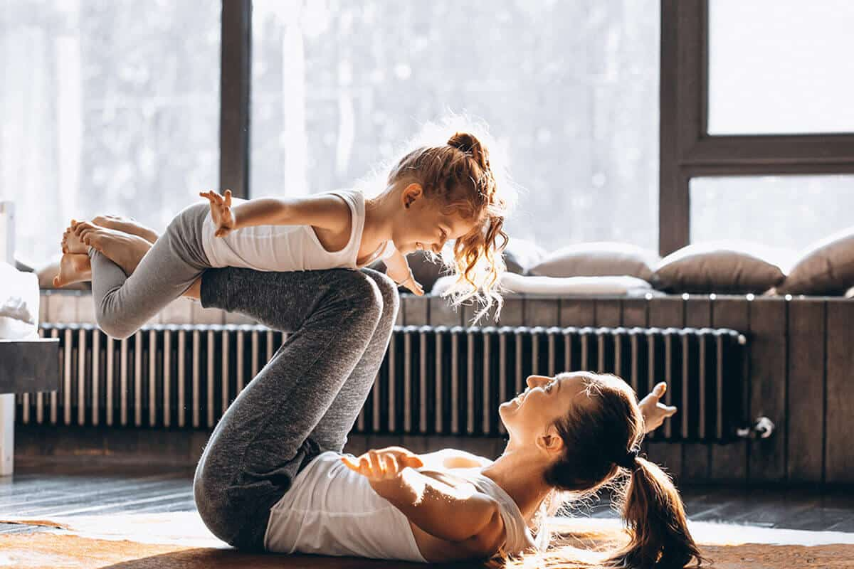 mom and daughter yoga pose