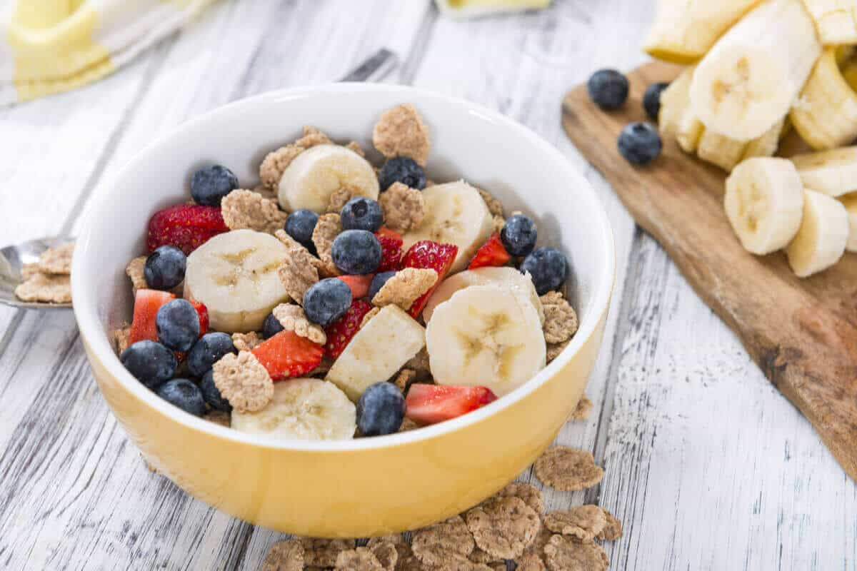 bowl with banana, berries, and oats