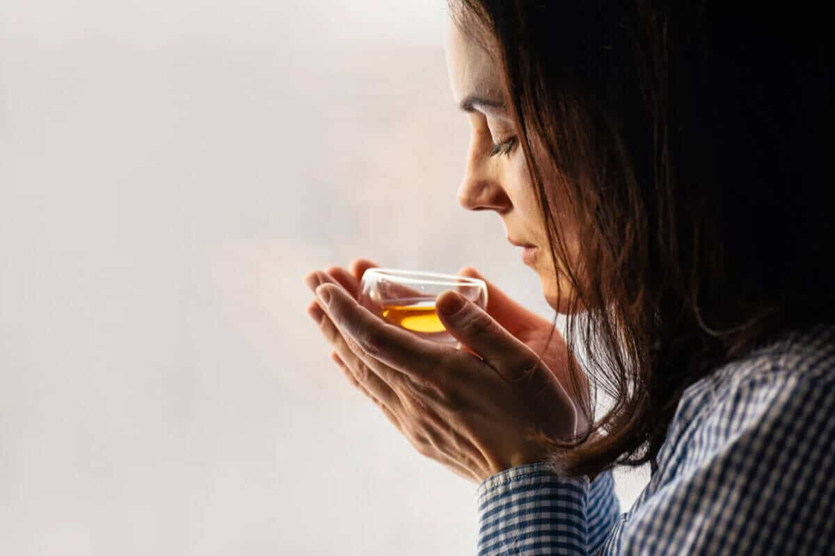 woman smelling her tea
