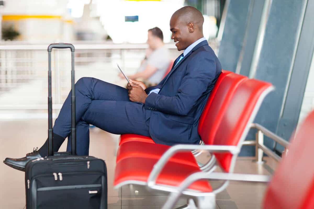 man sitting at the airport with luggage