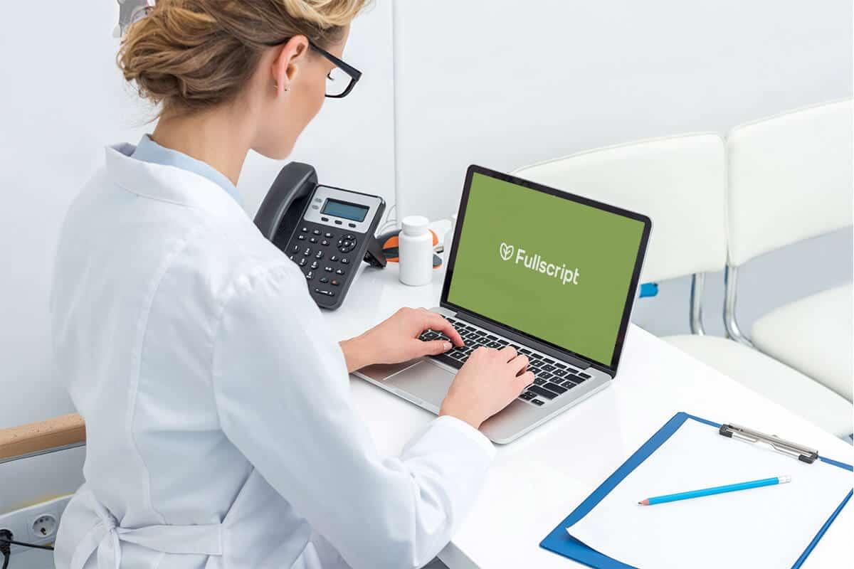 Practitioner accessing Fullscript on laptop