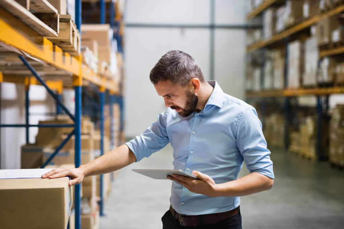 man looking at inventory in warehouse