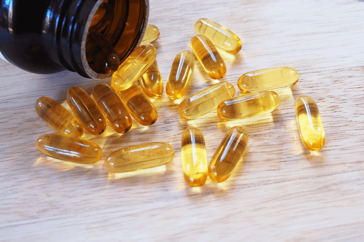 fish oil supplements on table from bottle