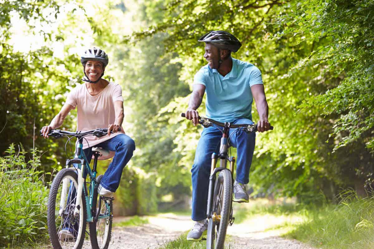 man and woman riding bikes outdoors