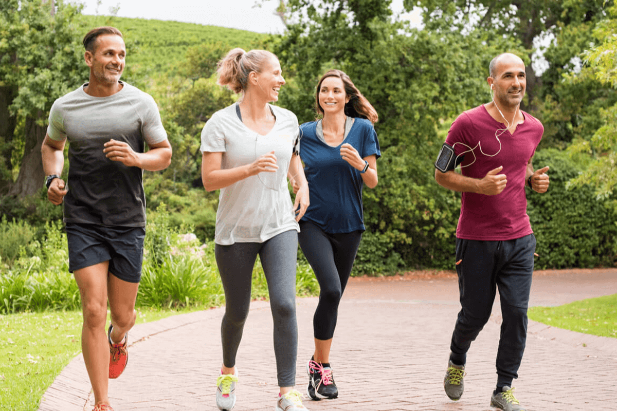 four people running together outdoors