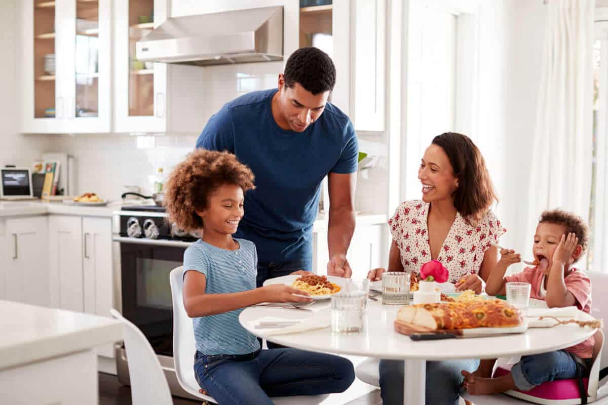 family of four eating at dinning table