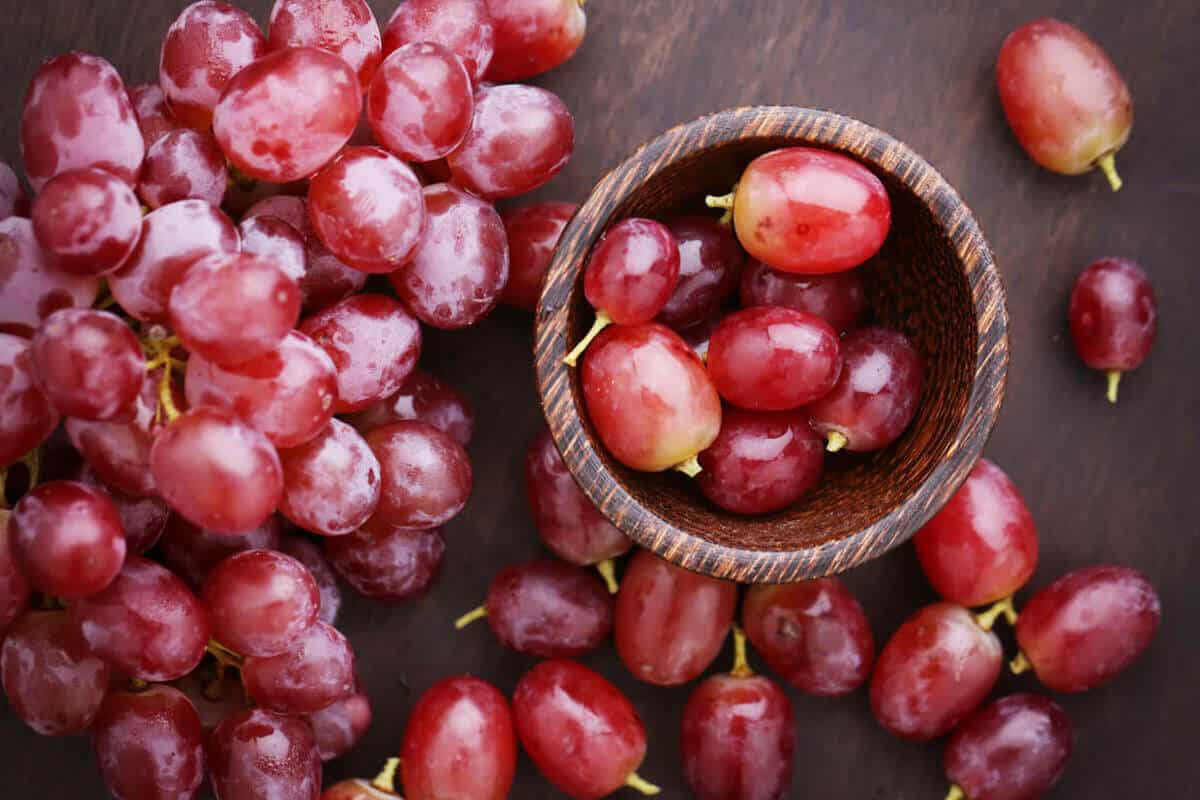 red grapes in a pile on a table