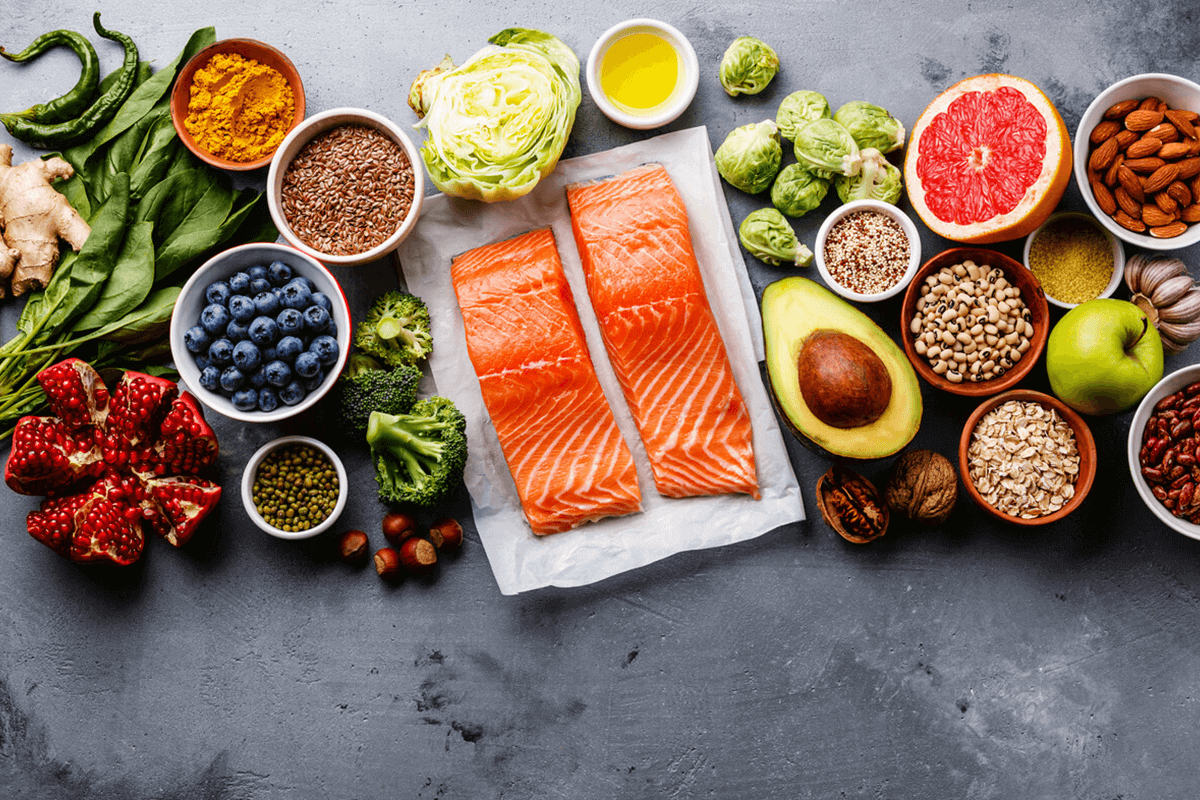 variety of raw foods including fish, vegetables, fruits, nuts and seeds