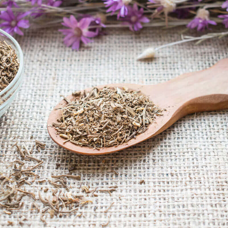 valerian root extract on a wooden spoon