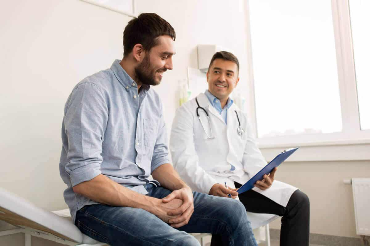 practitioner sitting and talking to their patient