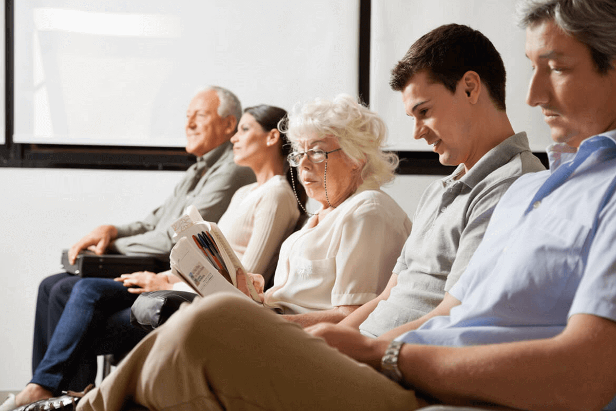 patients sitting in medical waiting room
