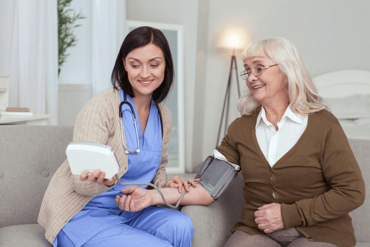 practitioner measuring patient's blood pressure