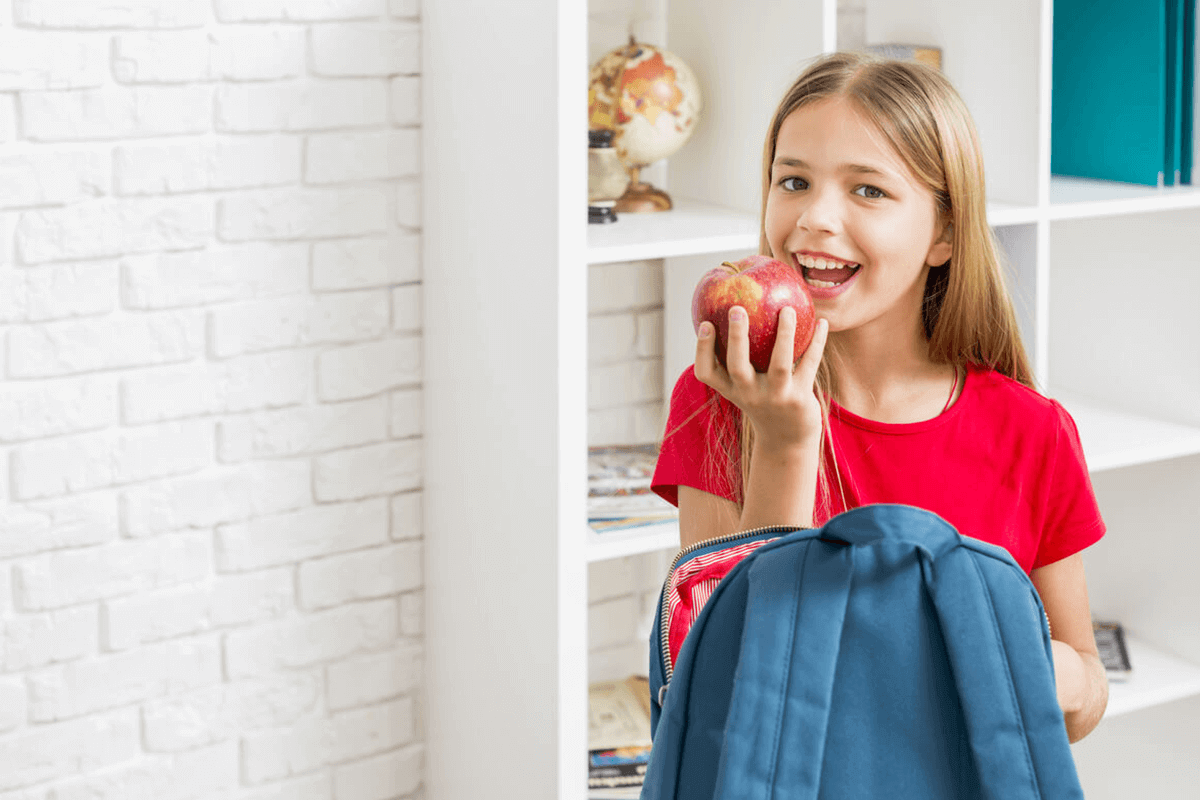 child holding a red apple
