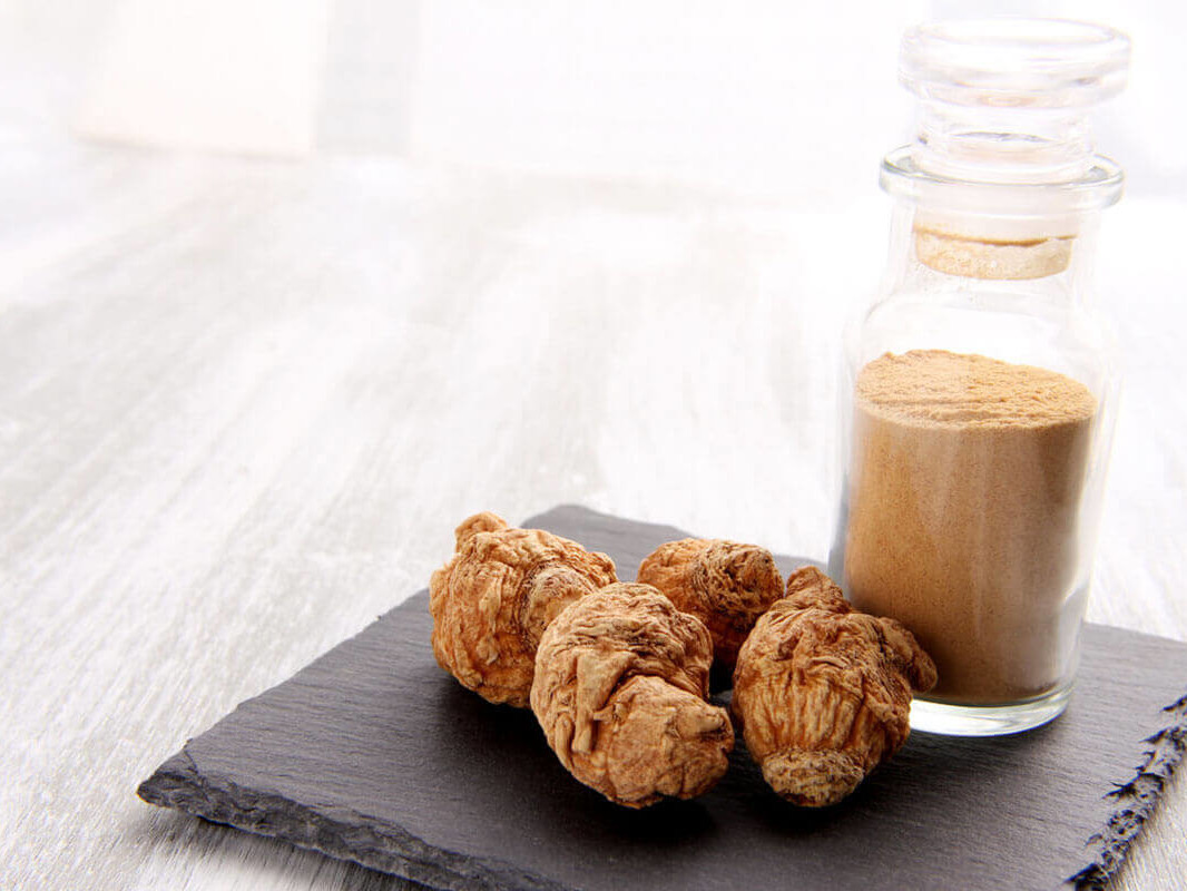 maca plant and plant extract in a glass bottle