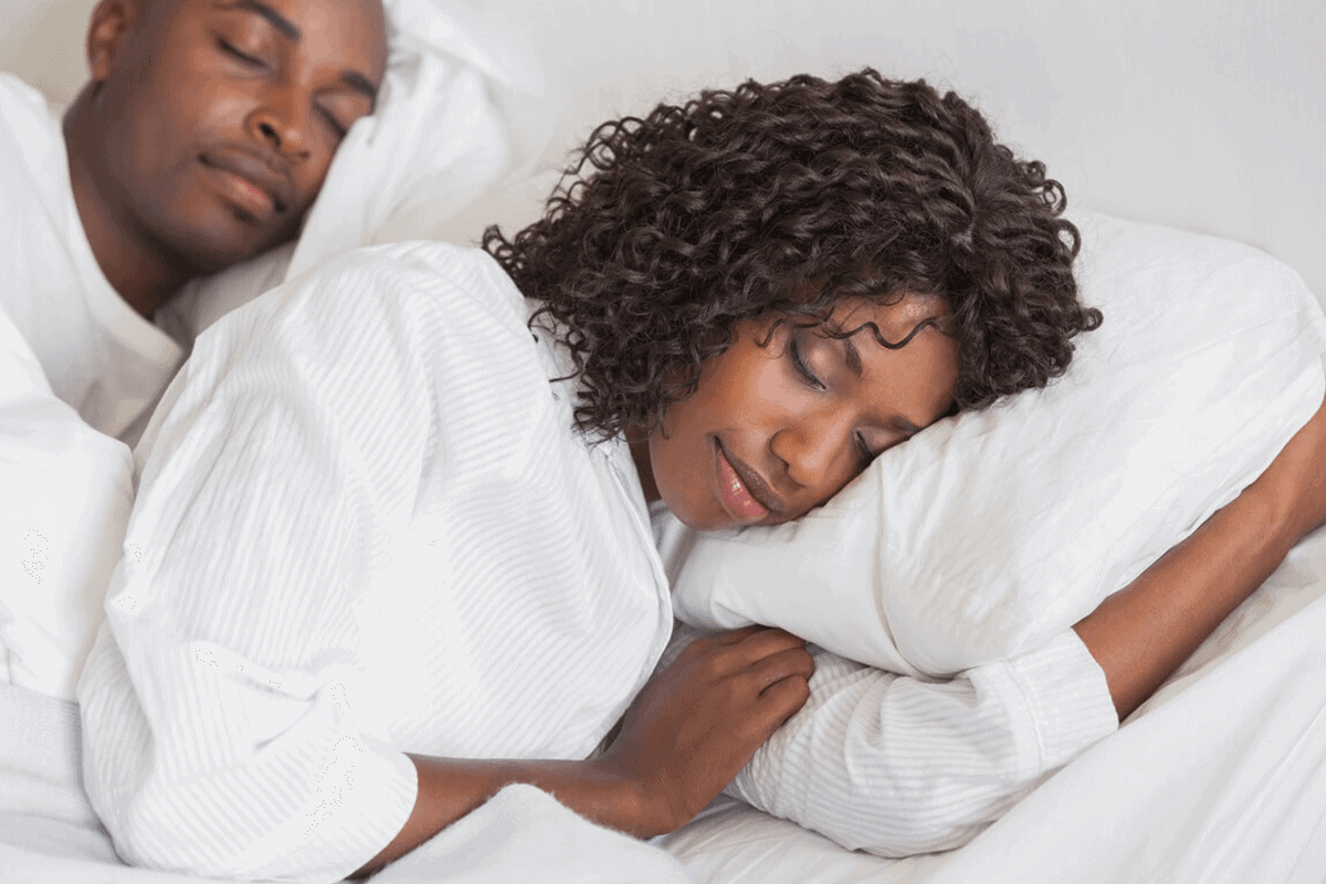 woman and man sleeping in bed