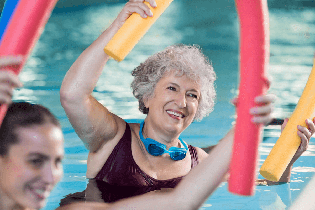 older woman doing aerobic in water