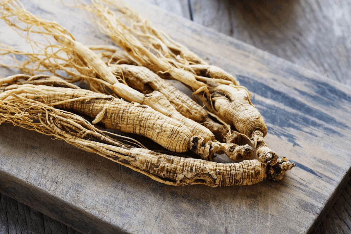 Ginseng root placed on a wooden background.