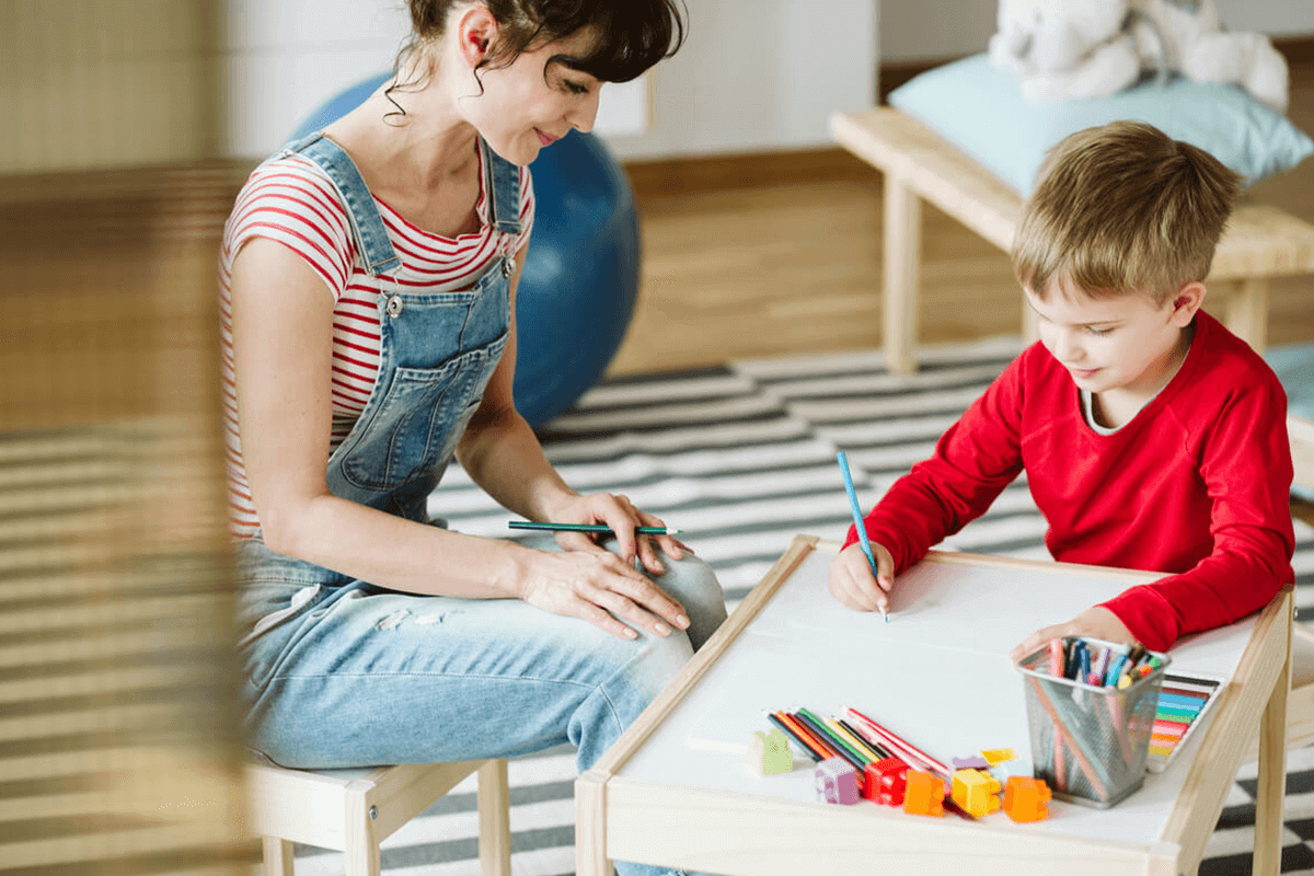 mother and son drawing together