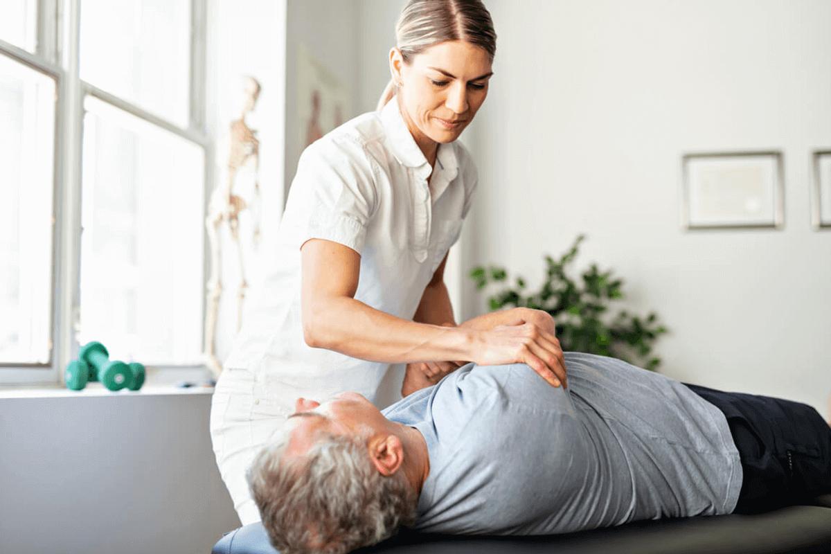 chiropractor working on patient's upper back