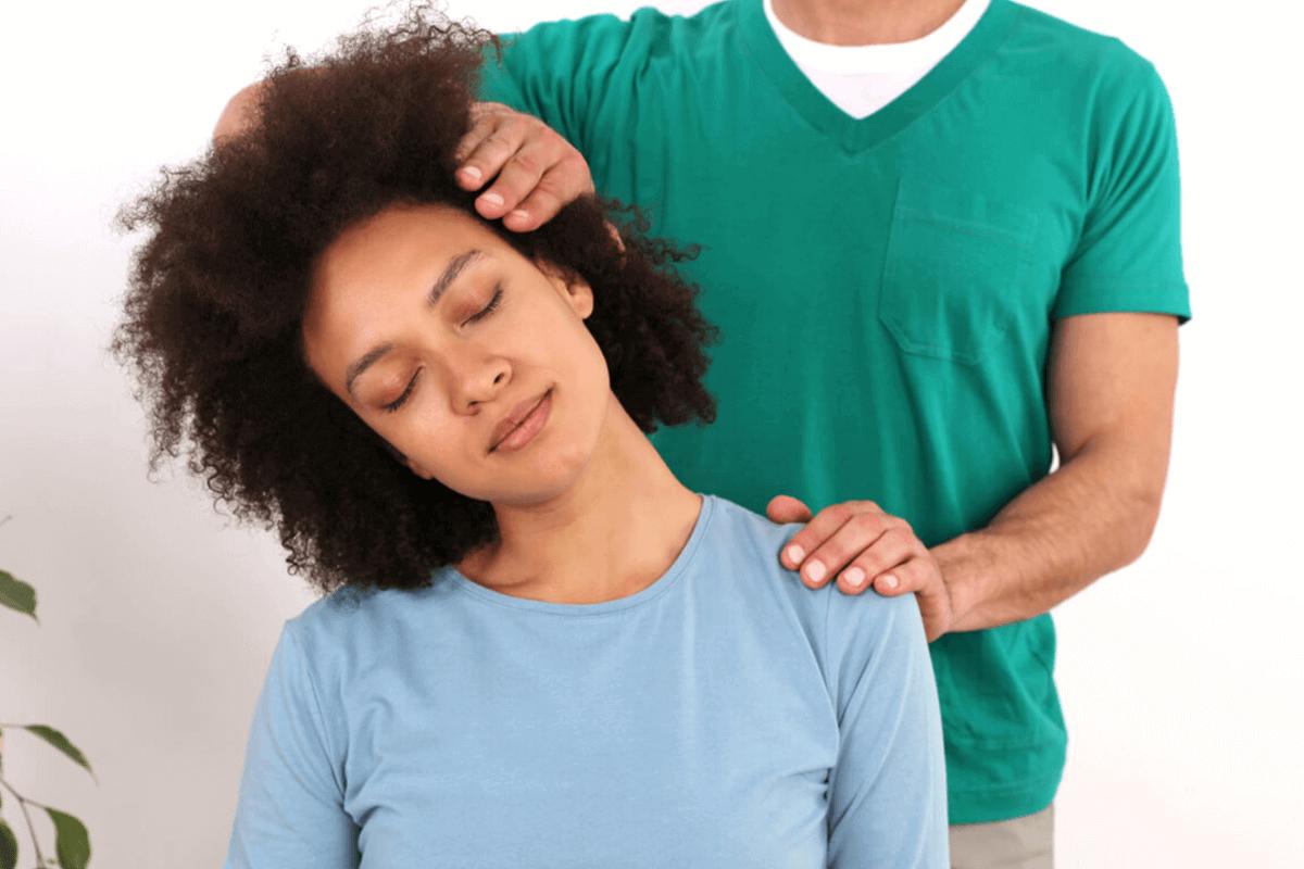 chiropractor working on patient's neck