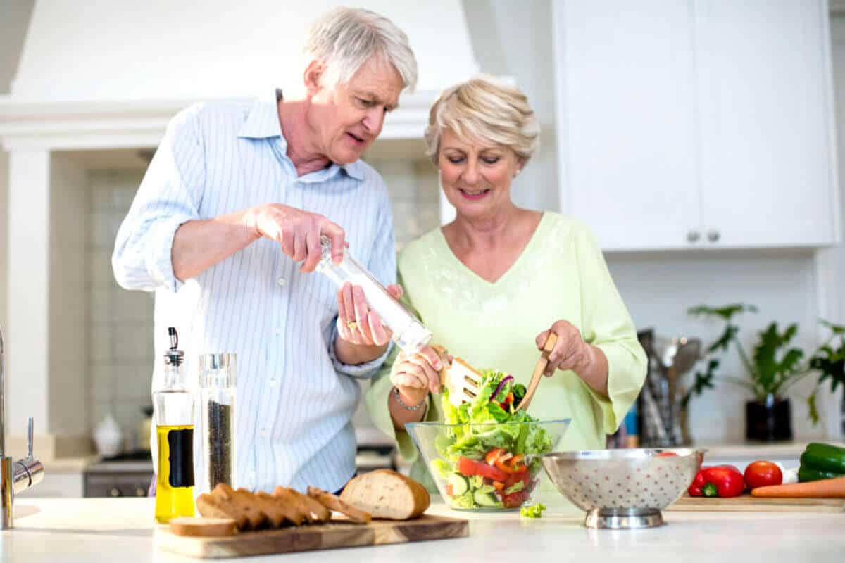 couple making food in kitchen