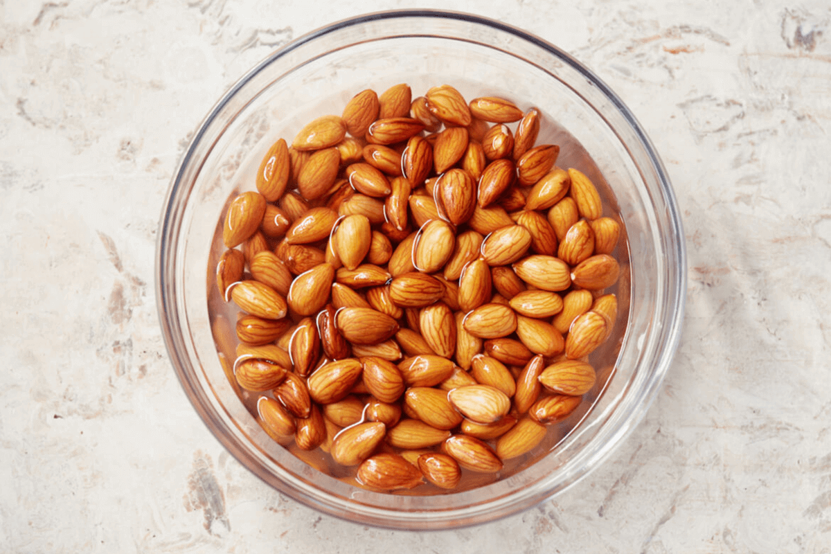 bowl with soaked almonds in water