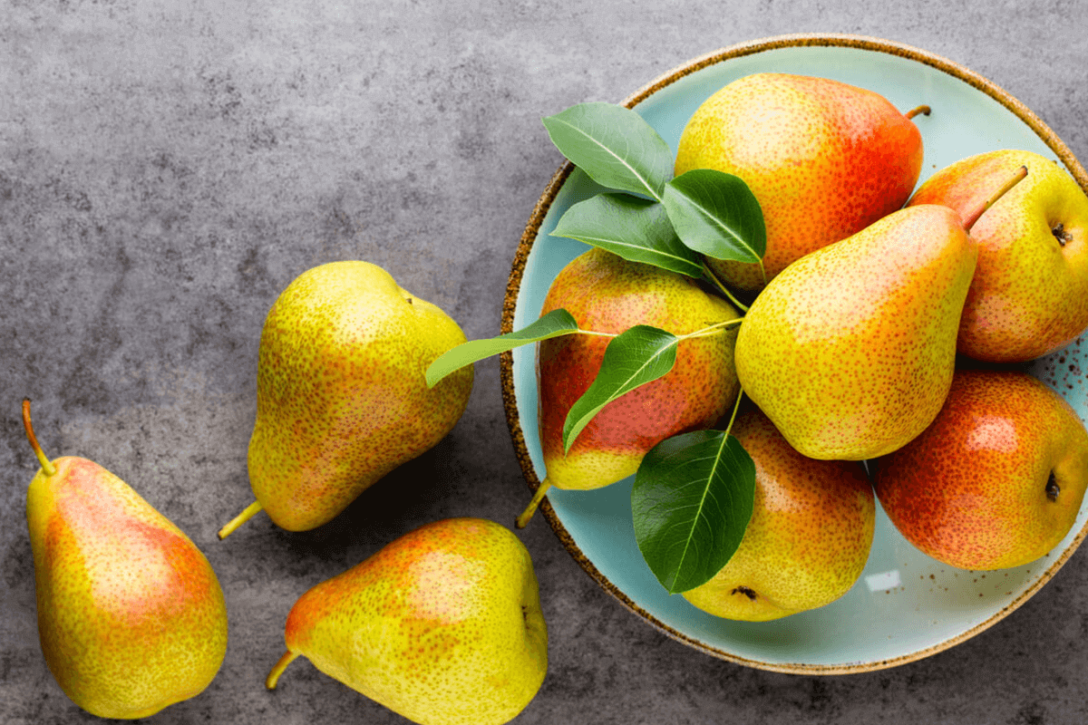 pears in a bowl and on the table