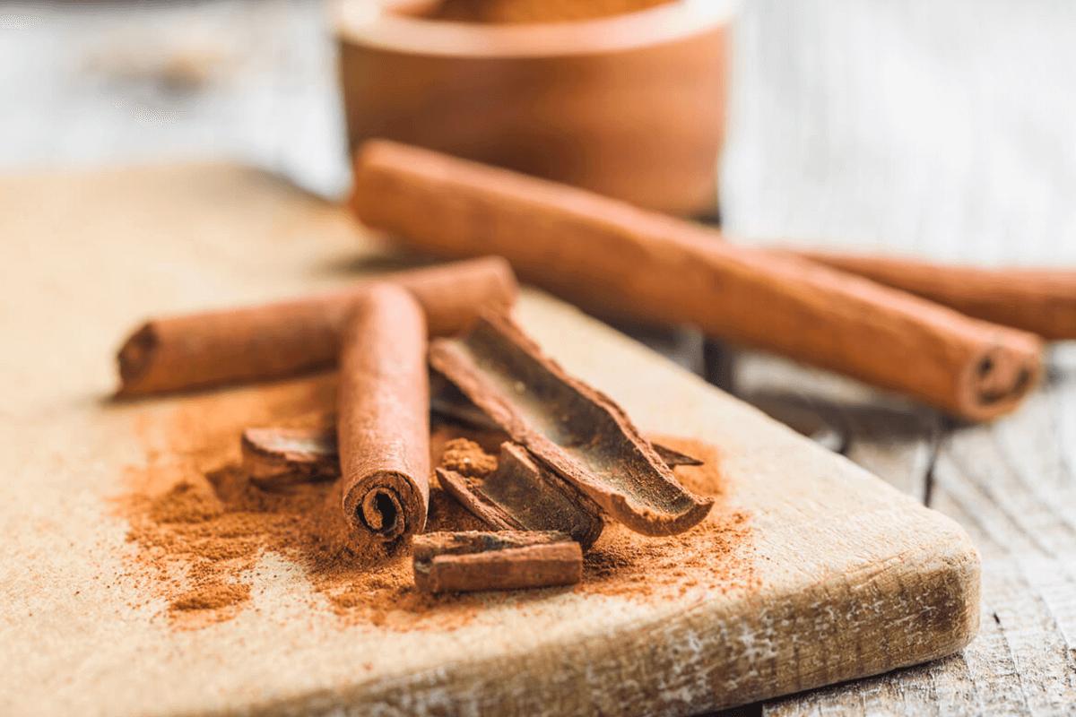Cinnamon sticks on a wooden board