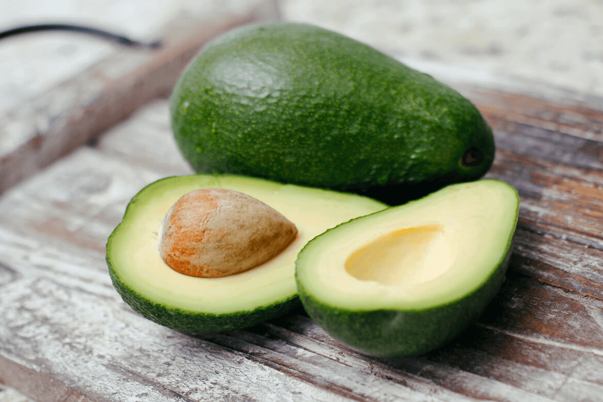 ripe green avocados on a table